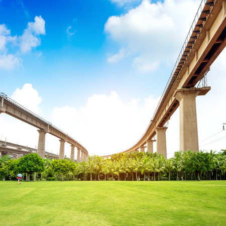 viaducts: Background of blue sky and white clouds, green lawns and viaducts.