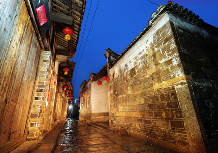 small town life: Rain China town, thousands of years alleys at night.