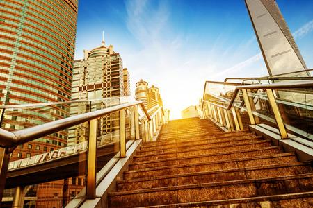 overbridge: Shanghai streets of stairs and escalators, skyscraper buildings. Stock Photo