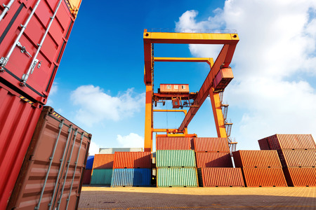 dockside: Cranes and container pier under the blue sky Stock Photo
