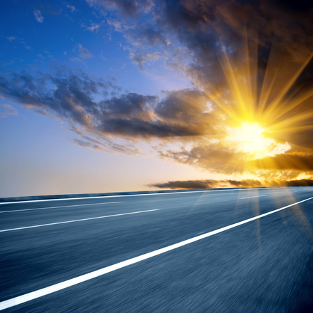 exaggerated: At dusk highway, modern transportation fantasy landscape, exaggerated expression.