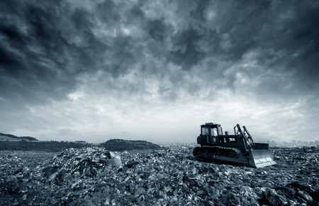 Transportation over the daily garbage piled garbage landfill. Stock Photo
