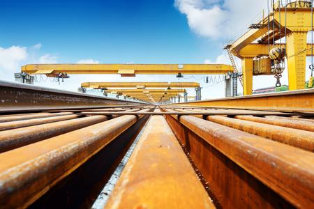 transported: Pier bridge crane and cargo handling, cargo trains transported away.