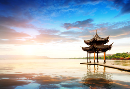 chinese pagoda: ancient pavilion in hangzhou with sunset glow,China