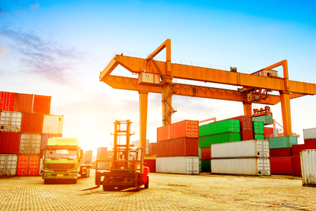 flatbed truck: Container operation in the port. Stock Photo