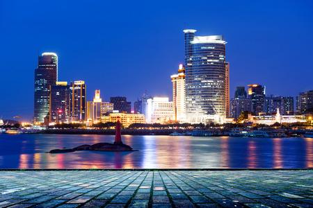 China Xiamen city night, seaside skyscrapers. photo