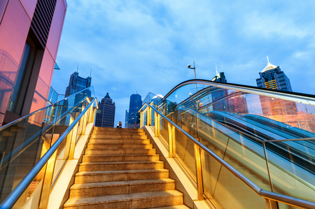 overbridge: China Shanghai night, the streets of escalators and skyscrapers.