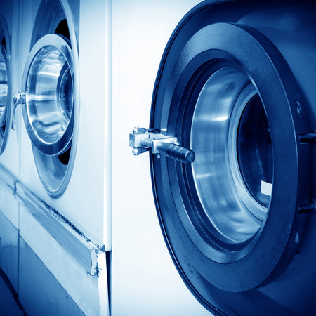 drycleaning: Public laundry machines standing in a row