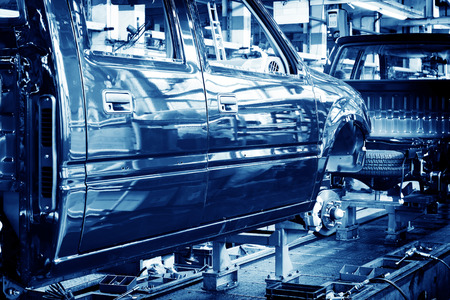 chassis: Factory floor, car production lines. Stock Photo