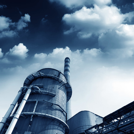 Power plant cooling towers and large chimney photo