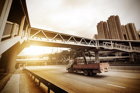 crossing street: Highway viaduct and people of Hong Kong Bank