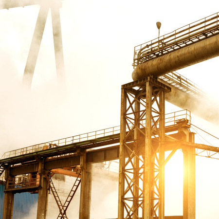 outburst: Steel mill crane, smoke-filled air pollution.