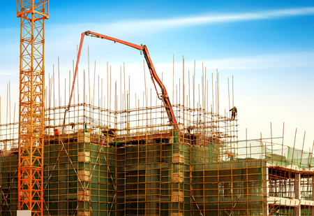 Construction site, workers and cranes. Stockfoto