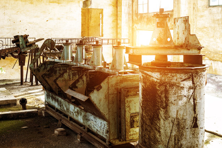 abandoned factory: Abandoned factory, rust-stained machine.