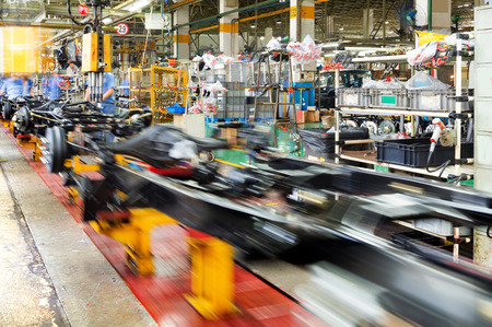 chassis: actory floor, car production line, motion blur picture. Editorial