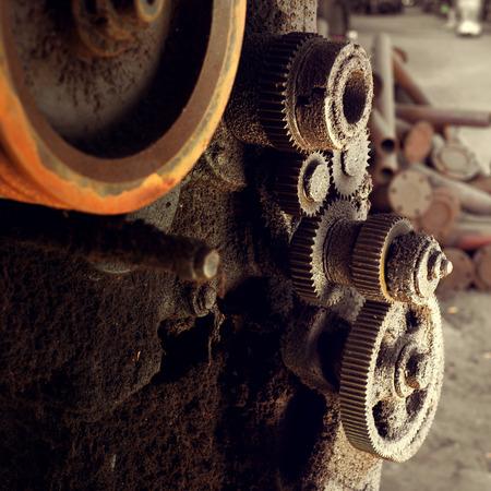 factory interior: Abandoned factory interior, rusty machine gears. Stock Photo