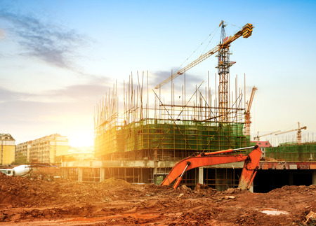 construction project: Construction site, workers and cranes. Stock Photo