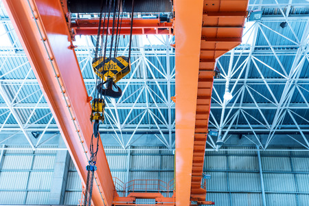 Inside large factories, bridge crane.