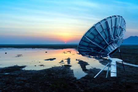 Dish on the prairie, early morning sunrise landscape. photo