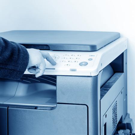 woman using copy machine photo