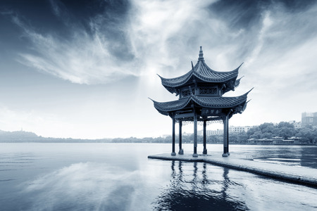 nature backgrounds: chinese ancient pavilion on the west lake in hangzhou Editorial