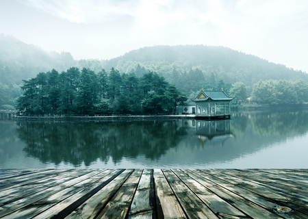 lake landscape in lushan,blue sky and the pavilion reflected in the water