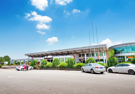trees services: Motorway service area under the blue sky