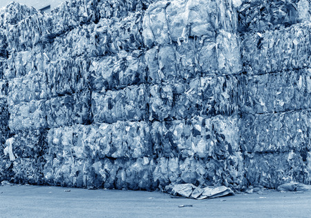 Plastic bottles pressed and packed for recycling