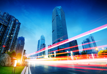 The light trails on the modern building background in shanghai china. Banque d'images