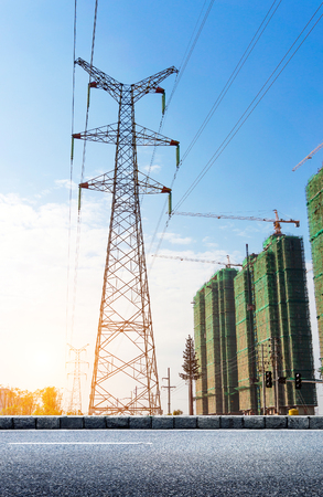 megawatt: electricity transmission pylon silhouetted against blue sky at dusk