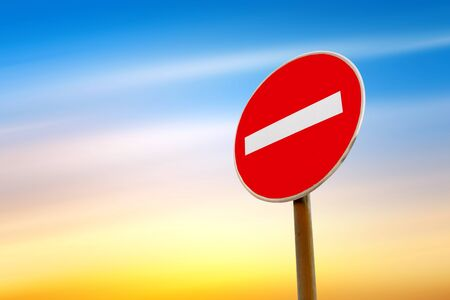 caution sign: Do not enter traffic sign over blue sky Stock Photo