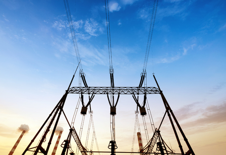 electrical equipment: Converter station under dusk sky, electrical equipment and wiring.