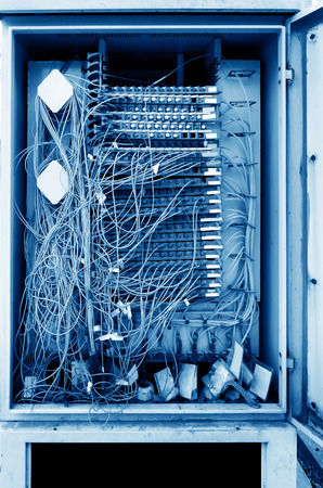 data distribution: Telecommunications distribution box close-up, crowded lines. Stock Photo