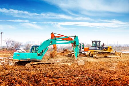 bulldozers: Large excavators and bulldozers at the construction site