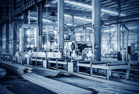 Steel factory production line, workers are working. Editorial