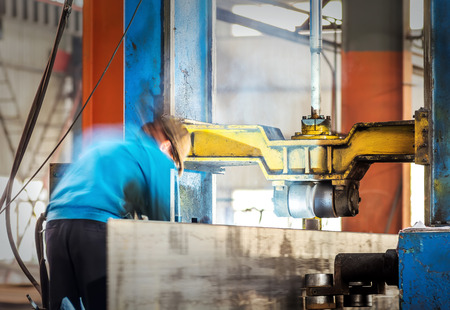 machinery machine: Workers to work alongside machinery leveler Stock Photo
