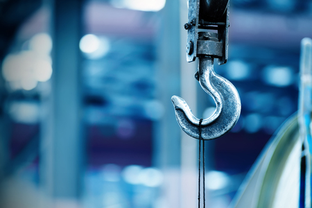 overhead crane: Inside the factory overhead crane hook Closeup Stock Photo