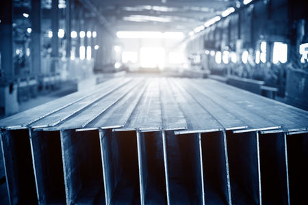metallurgist: Steel factory floor, stacked with a lot of steel Stock Photo
