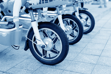 parked bicycles: The new electric bicycle, waiting for sales.