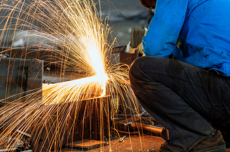 metal cutting: Workers at the construction site using a metal cutting torch