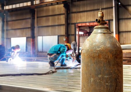 ongoing: Workers at work, ongoing welding operation. Stock Photo