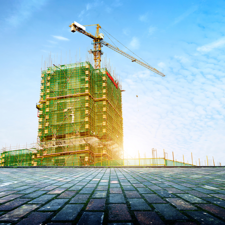 construction site: Construction site, workers and cranes. Editorial