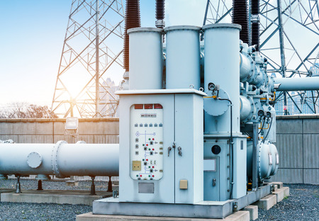 isolators: High voltage power transformer substation Stock Photo