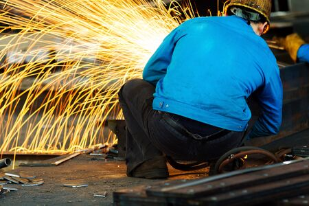 blowpipe: Workers at the construction site using a metal cutting torch
