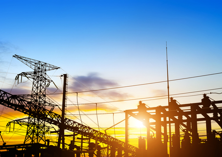 electricity substation: distribution electric substation with power lines and transformers, at sunset Stock Photo