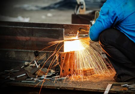 dangerous: Workers at the construction site using a metal cutting torch