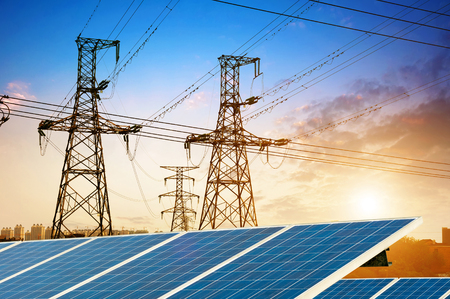 electrics: Solar Panel With High Voltage Tower in Background
