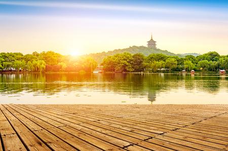 lakefront: hangzhou scenery,pagoda on the west lake lakefront in dusk