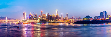 water  panoramic: cityscape and skyline of downtown near water of chongqing at night,panoramic.