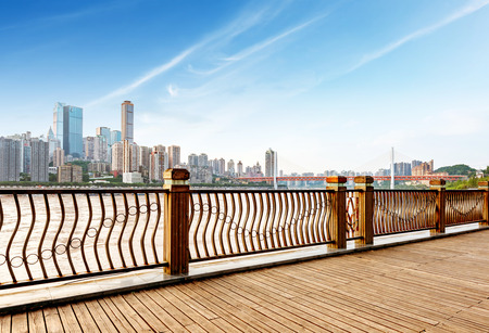 wooden floors: Chongqing city skyline, with wooden floors and guardrails. Stock Photo